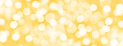 Holiday golden panoramic background, blurred bokeh lights. Holiday golden panoramic background with blurred bokeh lights stock photography
