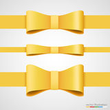 Holiday golden ribbon and bow. Stock Image