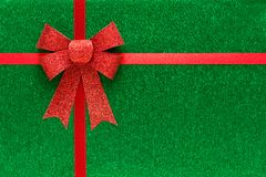Holiday green background with red ribbon Stock Photos