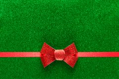 Holiday green background with red ribbon Royalty Free Stock Photos