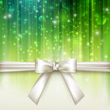 Holiday green background with a white bow Royalty Free Stock Photo