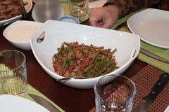 Holiday green bean dish on set table Royalty Free Stock Photo