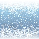 Holiday greeting background with snowflakes and falling snow on a sky backdrop. Vector illustration. Royalty Free Stock Photo