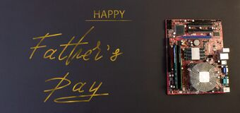 Free Holiday Greeting Card For Father`s Day On A Black Background - Machines, Computer Boards, With The Text - Happy Father`s Day Stock Photography - 182414392