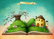 Magic book with Easter Egg House. Royalty Free Stock Photos