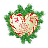Holiday greeting Card with xmas candy frame in heart shape and f. Ir-tree branches. Hand written calligraphic text Merry Christmas and Happy New Year. Isolated Royalty Free Stock Photos