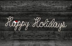 Holiday greeting rope design on black wood Stock Photos