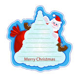 Holiday greeting sticker with a cheerful Santa Claus on a Christmas tree on a blue background. Frame for writing greetings in the Royalty Free Stock Image