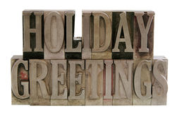 Holiday greetings in metal type stock image