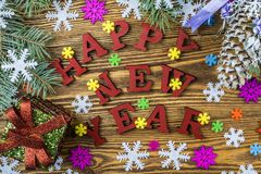 Holiday greetings on a wooden background with snowflakes, gift b. Happy New Year 2018 on a wooden background stock photography