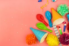 Holiday hats, whistles, balloons. Holiday hats, whistles, balloons on pink background. Concept of children`s birthday party Stock Photos