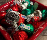 Holiday Hershey Kisses. A candy dish filled with Holiday wrapped chocolate Hershey Kisses Stock Image