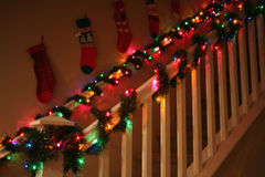 Holiday home. Lovely banisters decorated with Christmas garland and lights Royalty Free Stock Photo