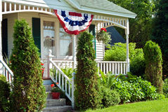 Patriotic flag bunting on a rural house Stock Images