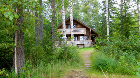 A holiday home. Cottage in the woods, next to lake Saimaa for relaxation during the weekend. Sulkava, Finland Stock Photos