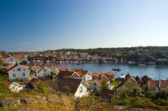 Holiday homes at the fjord. Holiday homes in summer at a fjord in South Sweden. Ideal for people with a boat Royalty Free Stock Photography
