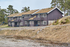 Holiday homes in the mountains, Norway. Gautefall, Norway - May 2, 2015: Adjacent wooden buildings for backpackers. Green roof. Early spring, around the Royalty Free Stock Photos