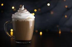 Holiday Hot Mocha with Whipped Cream. And Fairy Lights stock images