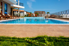 Holiday at the hotel pool Stock Image