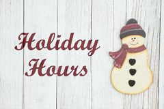 Free Holiday Hours Sign With Snowman Stock Photo - 144821900