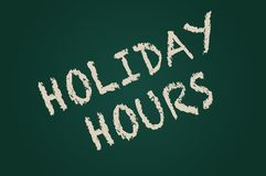 Holiday Hours written on board. Hollday hours written on blackboard stock photo