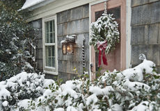 Holiday House. House Covered In Falling Snow During the Holidays Stock Image