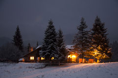 Holiday house. Winter landscape with a snowy house Royalty Free Stock Image