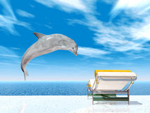 Holiday Impression with Jumping Dolphin and Deck Chair Royalty Free Stock Photo