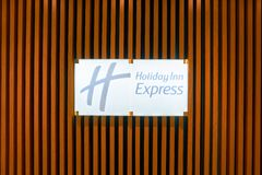 Holiday Inn Express. MOSCOW, RUSSIA - CIRCA AUGUST, 2018: close up shot of Holiday Inn Express sign. Holiday Inn Express is a mid-priced hotel chain within the royalty free stock photo