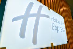 Holiday Inn Express. MOSCOW, RUSSIA - CIRCA AUGUST, 2018: close up shot of Holiday Inn Express sign. Holiday Inn Express is a mid-priced hotel chain within the stock image