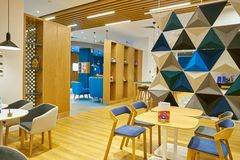 Holiday Inn Express. MOSCOW, RUSSIA - CIRCA AUGUST, 2018: interior shot of a Holiday Inn Express Hotel. Holiday Inn Express is a mid-priced hotel chain within stock images