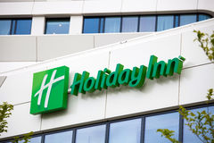 Holiday Inn Hotel sign in Amsterdam city, Netherlands. Amsterdam, Netherlands - April, 2017: Holiday Inn Hotel sign in Amsterdam city, Netherlands Royalty Free Stock Photography