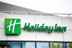 Holiday Inn Hotel sign in Amsterdam city, Netherlands. Amsterdam, Netherlands - April, 2017: Holiday Inn Hotel sign in Amsterdam city, Netherlands Royalty Free Stock Photos