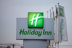 Holiday Inn logo on a sign in front of their main hotel in Serbia. Holiday Inn is a worldwide brand of hotels. Picture of the Holiday Inn sign next to their royalty free stock photography