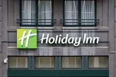 Holiday Inn sign on building in Brussels. Brussels / Belgium - 04 04 2019: Holiday Inn sign on hotel building in Brussels, Belgium stock photo
