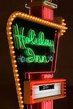 Holiday Inn sign. Vintage Holiday Inn hotel neon sign at night stock photos