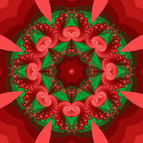 Holiday Kaleidoscope. Abstract kaleidoscope in christmas colors of red and green Royalty Free Stock Images