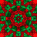 Holiday Kaleidoscope. Stained glass kaleidoscope in pretty christmas colors Royalty Free Stock Images