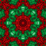 Holiday Kaleidoscope. Abstract kaleidoscope in christmas colors of red and green Stock Photography