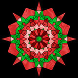 Holiday Kaleidoscope. Abstract kaleidoscope in christmas colors of red and green Royalty Free Stock Photography