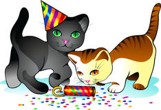 Holiday kittens. Kittens playing with confetti and celebratory firecrackers Royalty Free Stock Photos