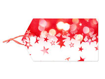 Holiday label with red stars falling Stock Image