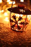 Holiday lantern. Lantern with snowflake with Christmas lights background stock photos