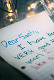 Holiday: Letter To Santa With Edison Bulbs Behind Royalty Free Stock Photos