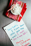Holiday: Letter To Santa Next To Cup Of Cocoa Royalty Free Stock Photo