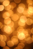 Holiday lights. Glowing background of festive lights for Christmas or Halloween stock photography