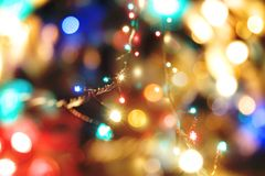 Holiday lights. On blurry bright background