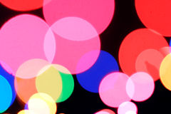 Holiday lights. Colorful defocused circles of light captured close up to create a holiday abstract Royalty Free Stock Image