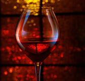 Holiday lights and wineglass Stock Image