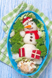 Holiday lunch for kids. Holiday lunch box with snowman for kids stock photos